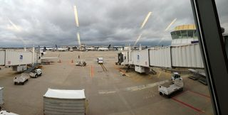A view of two gates at Washington Dulles Airport, after narrowly dodging a trip cancellation. Will 2013 get better for air travelers?