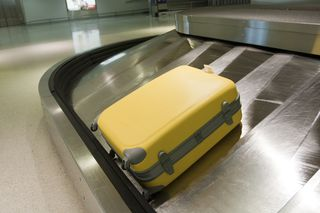 A lonely bag sits at the carousel waiting to be claimed by the owner. Have you considered what you would do if you had a baggage loss? This little yellow bag is sure worried about it.