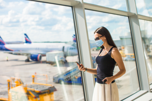 Shutterstock_1715383843_airport traveler with mask